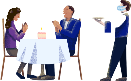 Couple dining out with cake on the table and server with tray